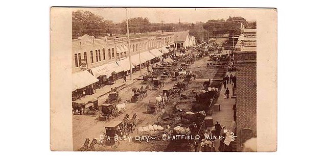 A postcard view of the main street of Chatfield, Minnesota in the late 1800s.