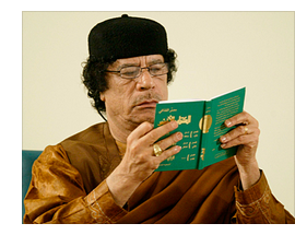 Muammar Gaddafi reading his Green Book