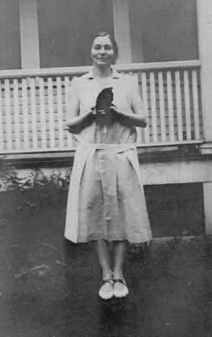 "Genevieve Taggard, around 1932, holding ""Blackie,"" a pet blackbird"