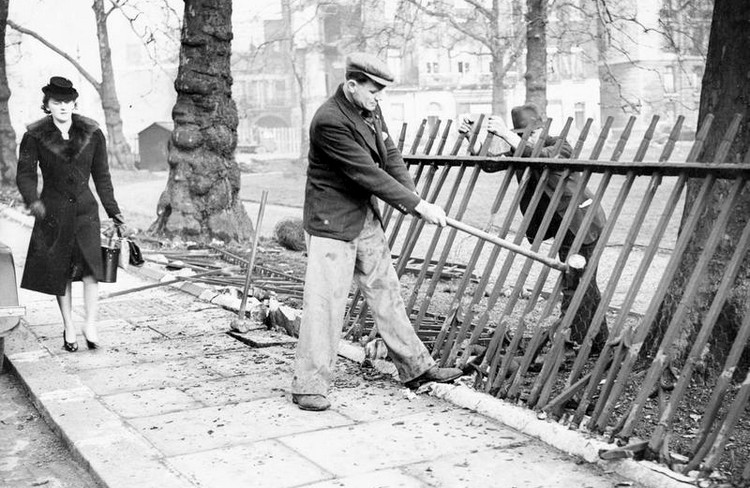 London park railings being dismantled for scrap metal, around 1941